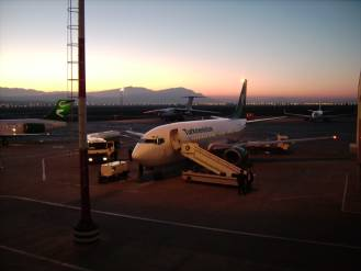 Ashgabat International Airport with plane at sunset