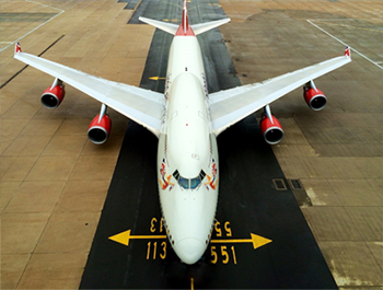 Looking down at a 747 showing its distinct humped front