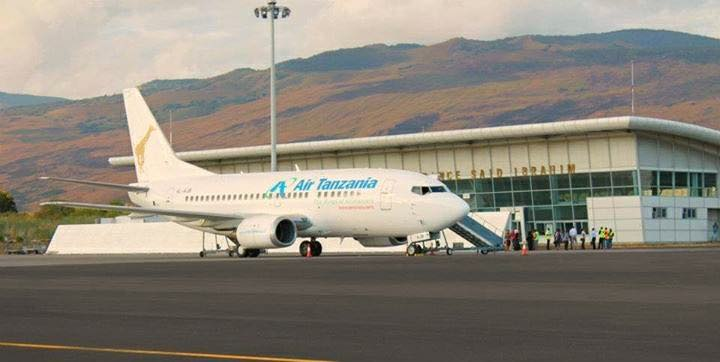 Exterior view of Prince Said Ibrahim International airport and side view of aircraft