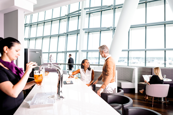 Aspire lounge gatwick with passengers at bar