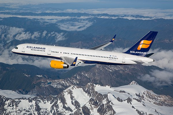 Icelandair aircraft flying over mountains