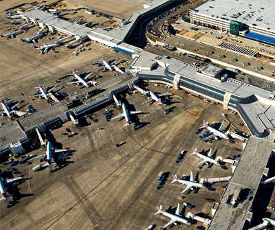 Birdseye view of Charlotte International, showing aircraft on the tarmac and concourse buildings