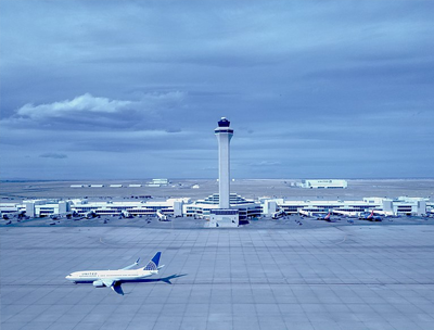 Exterior shot of Denver Airport, showing the main terminal building and air plane