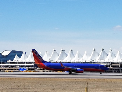 Exterior shot of Denver airport, showing the pointed architectural design of the main terminal building