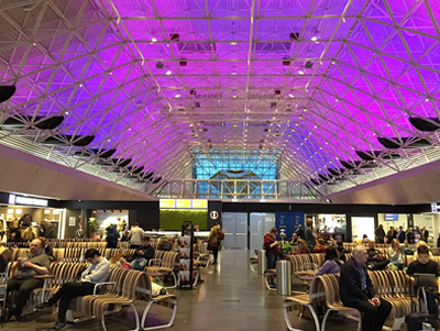 KEF interior shot showing the main waiting area, with high roof and lit with blue and purple lights