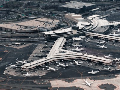 Birds eye view of Newark Liberty International Airport, showing terminal 3 and runways from the sky
