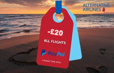 Red and light blue baggage tags overlaid on beach and sunset view