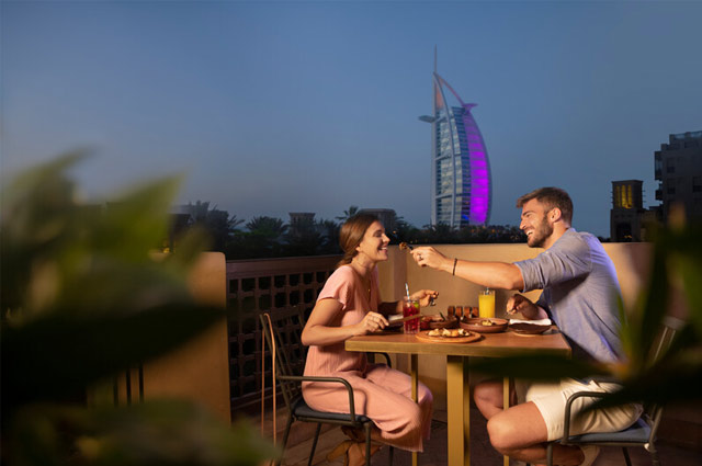 People dining in Dubai in the evening
