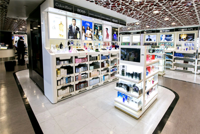 Duty free shopping at the airport, showing a concessions stand with perfumes