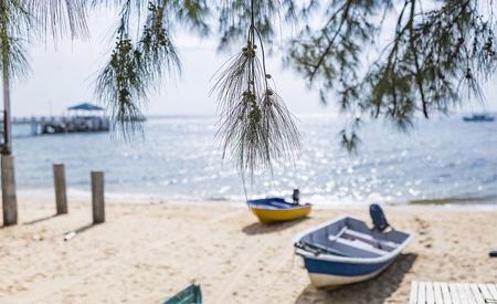 2 small boats on sandy beach