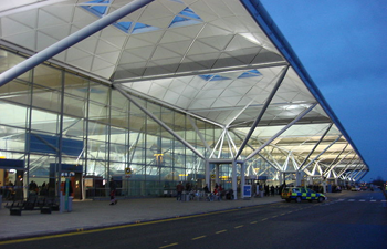 london stansted airport exterior shot showing modern glass front