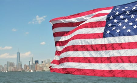 US flag waving in front of New York