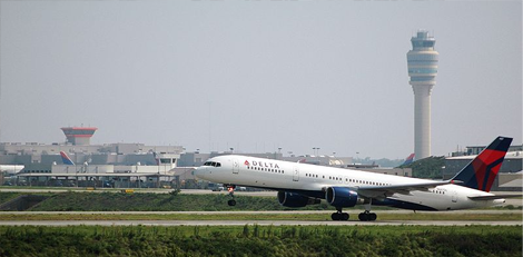 Delta plane on runway with atlanta airport in the background