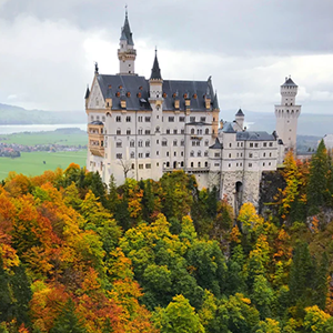 castle surrounded by warm autumn trees