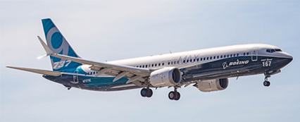 Boeing 737 MAX 9 aircraft, with no branding, flying