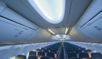 Interior of the Boeing 737 MAX, focusing on the sculpted sidewalls and larger baggage bins