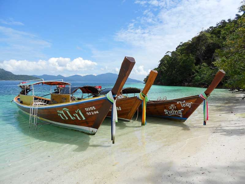 Wooden boats decked at peaceful beach