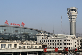 exterior shot of airport building, with 'Chengdu' sign above modern glass front
