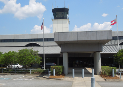 columbus airport exterior shot showing control tower and terminal building entrance