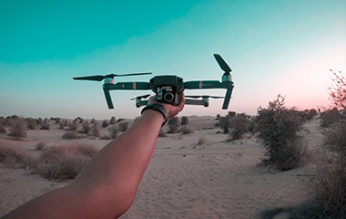 drone being held in the desert