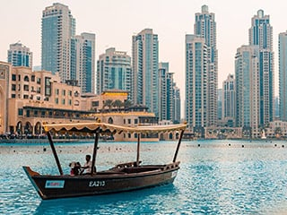 dubai city in the day with boat on water