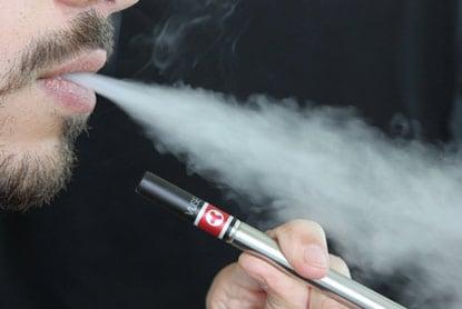 photo of man smoking an e-cigarette