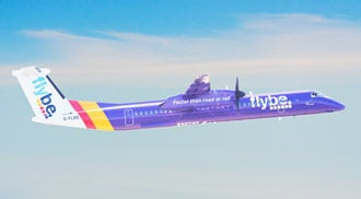 Flybe Q400 aircraft in sky