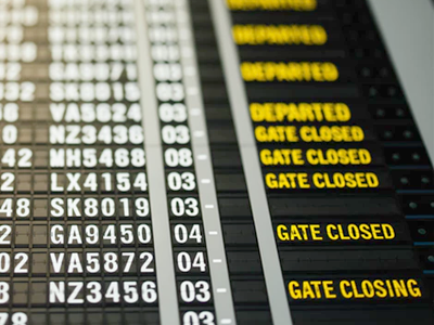 A flight departure board, displaying the notice that gates have closed and are closing