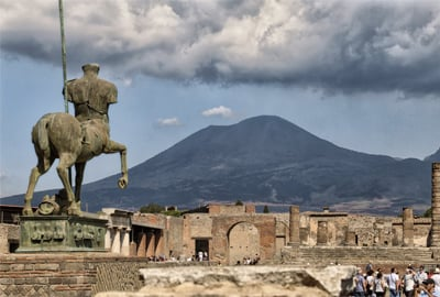 photo of pompeii archeological site with mt Vesuvius in the background