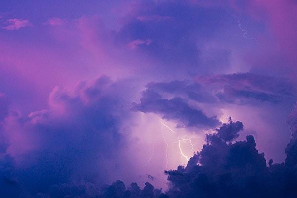 Purple stormy sky with lightning