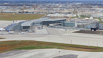 birds eye view of winnipeg airport showing planes on tarmac and the main terminal building
